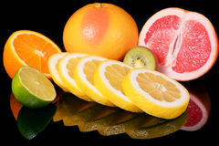 Fresh citrus isolated on black background Royalty Free Stock Photos