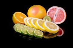Fresh citrus isolated on black background Stock Images
