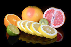 Fresh citrus isolated on black background Stock Images