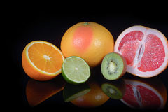 Fresh citrus isolated on black background Stock Photos