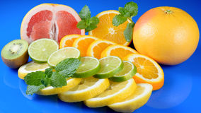 Fresh citrus isolated on blue background Stock Photos