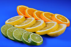 Fresh citrus isolated on blue background Stock Photo