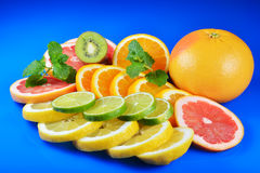 Fresh citrus isolated on blue background Stock Photography