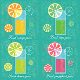 Fresh citrus juices on blue background Royalty Free Stock Photo