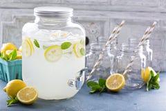 Fresh citrus lemonade in beverage dispenser Stock Photography