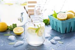 Fresh citrus lemonade in beverage dispenser Royalty Free Stock Photography