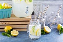 Fresh citrus lemonade in beverage dispenser Stock Photo