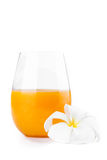 Fresh citrus orange juice with white frangipani flower on white Royalty Free Stock Photo