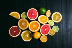 Fresh citrus stihli. Lemons, limes, grapefruit and orange on a black background.  stock image