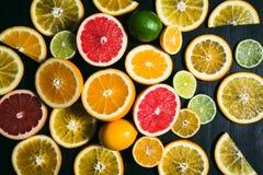 Fresh citrus stihli. Lemons, limes, grapefruit and orange on a black background.  Stock Photo
