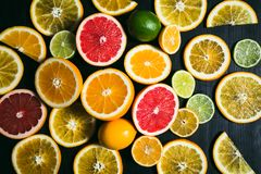Fresh citrus stihli. Lemons, limes, grapefruit and orange on a black background Stock Photo