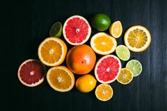 Fresh citrus stihli. Lemons, limes, grapefruit and orange on a black background.  stock photos