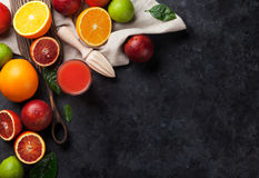 Fresh citruses and juice Royalty Free Stock Image