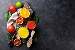 Fresh citruses and juice Royalty Free Stock Images