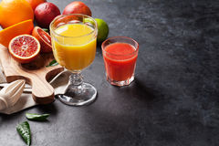 Fresh citruses and juice Stock Photos