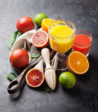 Fresh citruses and juices Royalty Free Stock Image