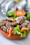 Fresh clams. Over a tray with vegetables Stock Photos