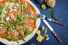 Fresh classic italian pizza with pasta and Cutlery, top view, flat lay Royalty Free Stock Photo