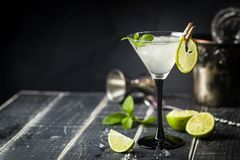 Fresh classic lime margarita cocktail. Over black background stock image