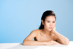 Fresh clean face of Young woman. Refreshing and clean face of young woman face leaning on hand Royalty Free Stock Image