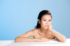 Fresh clean face of Young woman. Refreshing and clean face of young woman lean on palm Royalty Free Stock Photo