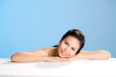 Fresh clean face of Young woman. Refreshing and clean face of young woman with sweet smile lean on hand Stock Images