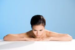 Fresh clean face of Young woman. Refreshing and clean face of young woman with hands stretching on table Stock Photo