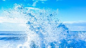 Fresh clean white water ocean wave splash. Fresh clean pure white water sea ocean wave splash against blue sky Royalty Free Stock Photos