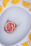 Fresh and Clean Toilet. Fresh fruit on toilet seat. Cleanness and freshness concept Stock Photo
