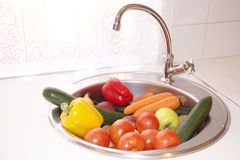 Clean vegetables in a sink Stock Images