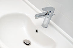 Fresh and clean washbasin and chrome tap Royalty Free Stock Photography