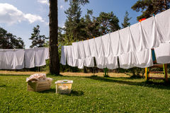 Fresh clean white towels drying on washing line. In outdoor royalty free stock photo