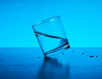 Fresh clear blue water splash in glass Royalty Free Stock Photos