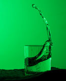 Fresh clear water splash in glass Royalty Free Stock Images