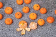 Fresh Clementines Mandarin fruit peeled on stone. Fresh Clementines Mandarin fruit peeled on grey stone Stock Image