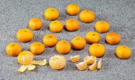 Fresh Clementines Mandarin fruit peeled on stone. Fresh Clementines Mandarin fruit peeled on grey stone Royalty Free Stock Photography