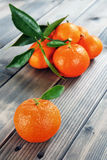 Fresh clementines organic farming, on wooden base Royalty Free Stock Photos