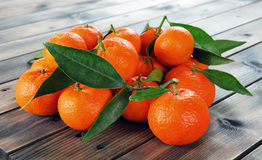 Fresh clementines organic farming, on wooden base Royalty Free Stock Photography