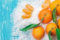 Fresh clementines in snow stock image