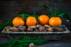 Fresh Clementines or Tangerines in the Basket Stock Photos