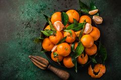 Fresh clementines tangerines with leaves on dark greeen backgr. Ound, top view, square image Stock Photo