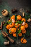Fresh clementines tangerines with spices on dark greeen backgroun. D, top view. Winter or Christmas food concept Stock Image