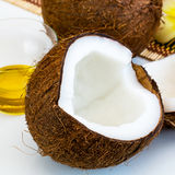 Fresh close up coconut and oil for alternative therapy Stock Photo