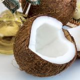 Fresh close up coconut and oil for alternative therapy Stock Photos