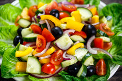 Fresh Close Up Vegetable Salad with, black olives, cherry tomatoes, yellow pepper, red onion, cucumber. Royalty Free Stock Images