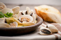 Fresh Cockle clams (Venus, Meretrix) with wine sauce. Portuguese Royalty Free Stock Images