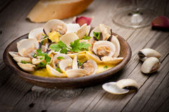 Fresh Cockle clams (Venus, Meretrix) with wine sauce. Portuguese Royalty Free Stock Photo