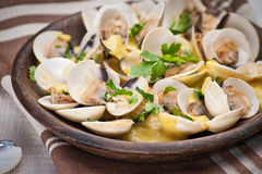 Fresh Cockle clams (Venus, Meretrix) with wine sauce. Portuguese Royalty Free Stock Photography