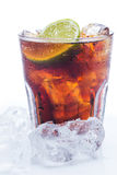 Fresh cocktail with cola drink and lime Stock Images