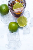 Fresh cocktail with cola drink and lime Royalty Free Stock Photos